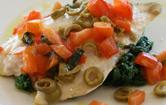 Orata con pomodori e olive